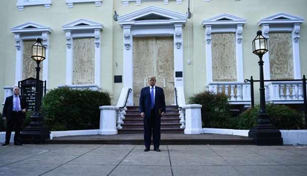 US President Donald Trump in front of boarded up St John's Episcopal church after walking across Laf