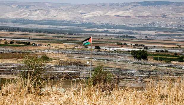 A Palestinian flag is seen in the village of Bardala in the Jordan Valley in the occupied West Bank,
