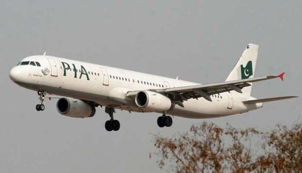 A Pakistan International Airlines (PIA) plane prepares to land at Islamabad airport in Islamabad