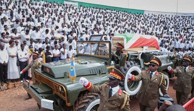The coffin, covered with he Burundi national flag, of late Burundi President Pierre Nkurunziza, who
