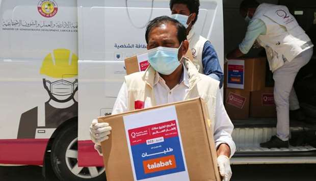 QC, in co-operation with Talabat, distributed the food parcels to workers and families affected by t
