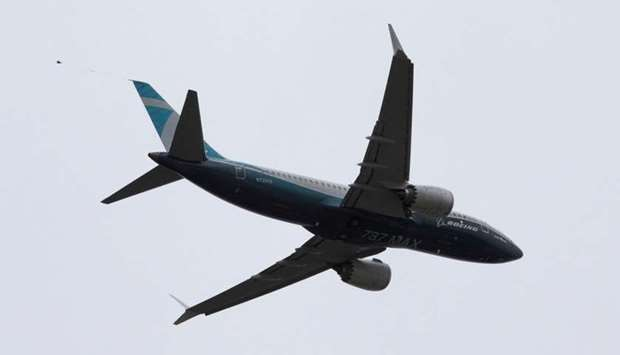 A Boeing 737 MAX airplane takes off on a test flight from Boeing Field in Seattle, Washington
