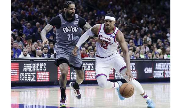 Brooklyn Nets forward Wilson Chandler (left) in action against the Philadelphia 76ers during a regul
