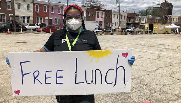 ANNOUNCEMENT: Rosalind Pichardo advertises a daily food giveaway service in the heart of Philadelphi