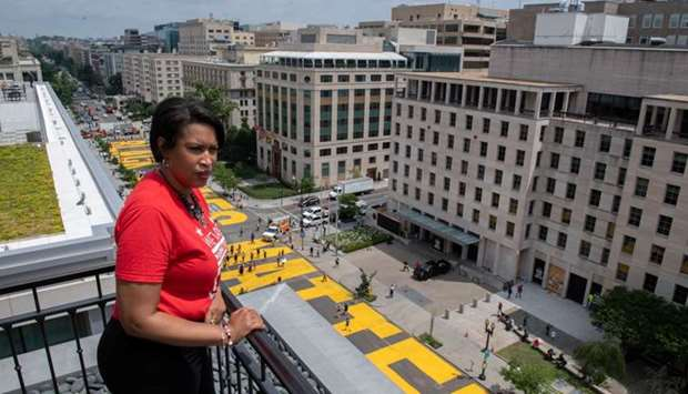 Mayor Muriel Bowser looks out over a Black Lives Matter sign that was painted on a street, during na