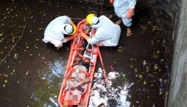 The rescuers work to take Jacob Robert out of the well