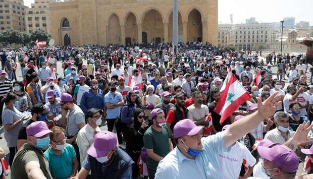 Lebanese protesters shout slogans during a demonstration in front of Mohamed al-Amin mosque in centr