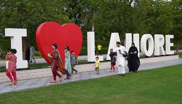 Members of a family enjoy a stroll at Lahore's Jilani park after it reopened with the easing of the