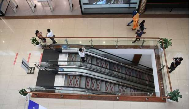 Customers walk inside Select CITYWALK mall after the government eased a lockdown imposed as a preven