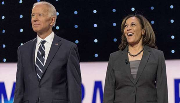 A CHANCE? Joe Biden and Kamala Harris pose for the photo spray during a commercial break at the seco