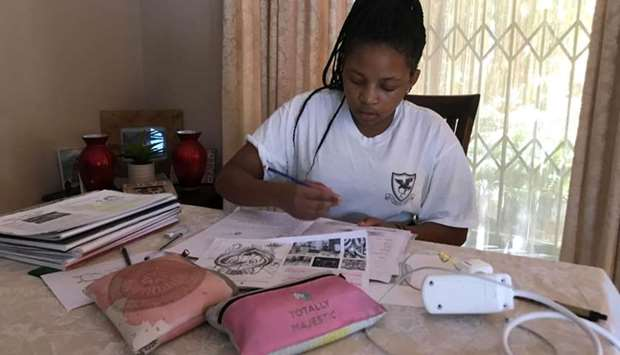 Learner Zinzi Lerefolo practices drawing after a virtual art class at her house as the country ponde