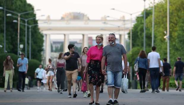 People walk at the Gorky Central Park of Culture and Leisure after local authorities partially lifte