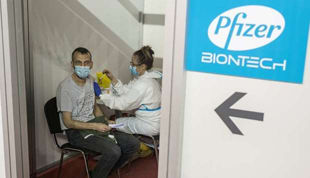 A man receives a second dose of the Pfizer-BioNTech vaccine against the coronavirus disease (Covid-1