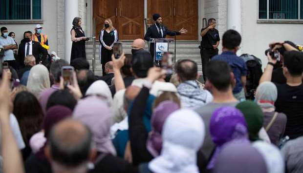 New Democratic Party (NDP) leader Jagmeet Singh speaks from the podium at a vigil for the victims of