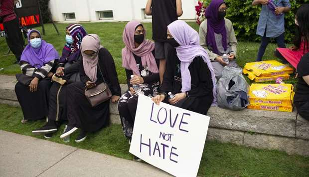 Muslim community members gather for a vigil at the London Muslim Mosque in London, Canada.