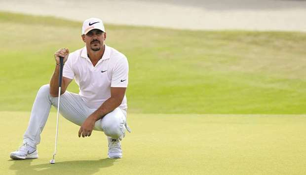 Brooks Koepka of the United States lines up a putt on the 15th green during the third round of the 2