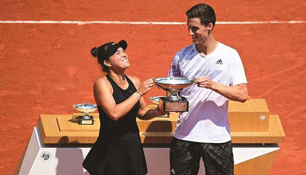 Desirae Krawczyk (left) of the US and Britain's Joe Salisbury celebrate with the trophy after winnin