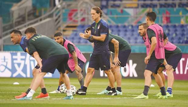 Italy coach Roberto Mancini (centre) looks on as players train yesterday in Rome, ahead of their Eur