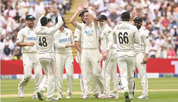 New Zealand's Matt Henry (centre) celebrates after dismissing England's Dom Sibley on the first day