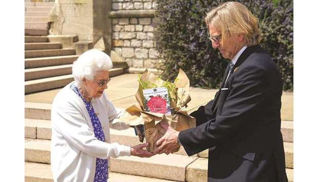 Royal Horticultural Society president Keith Weed presents Queen Elizabeth II with a Duke of Edinburg