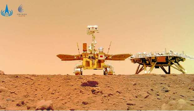 Chinese rover Zhurong and the lander of the Tianwen-1 mission, captured on the surface of Mars by a