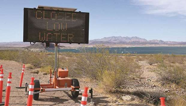 A sign notifies that a boat launch is closed because of low water levels due to drought in the Hoove