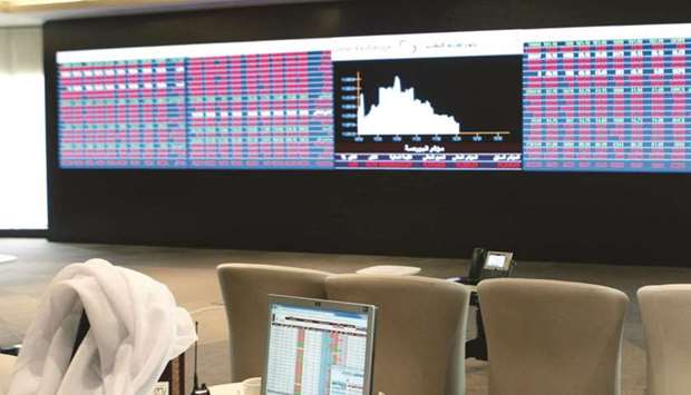 An investor monitors financial data at the Qatar Stock Exchange. The Group Securities and QNBFS toge