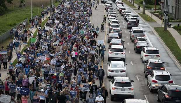 """Members of the Muslim community and supporters gather for a multi-faith """"March to End Hatred"""" on Jun"""