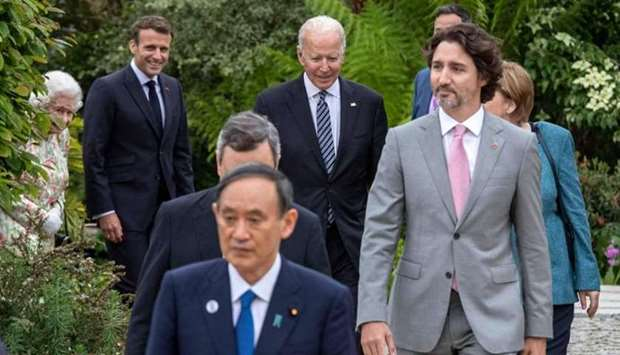 US President Joe Biden (C) and G7 leaders arrive for a family phtotograph during a reception at The
