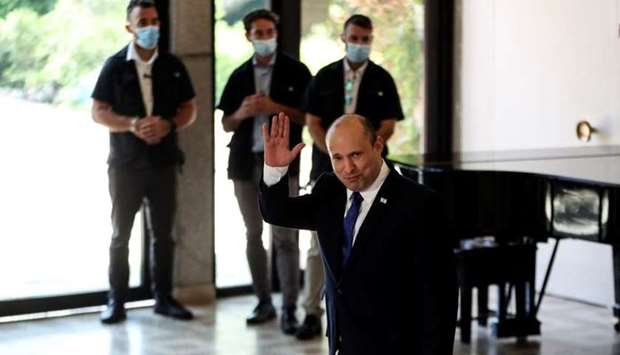 Israel's Prime Minister Naftali Bennett arrives to take part in a group photo with ministers of the