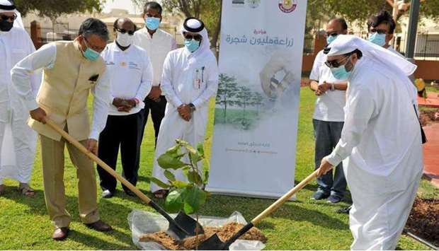 Dr Deepak Mittal and Mohamed Ibrahim al-Saada planting a tree during the event on Monday.