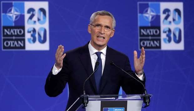 NATO Secretary General Jens Stoltenberg gives a press conference during a NATO summit at the North A