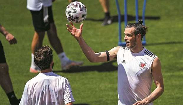 Wales' captain Gareth Bale (right) at a training session at the Tofiq Bahramov Stadium in Baku yeste