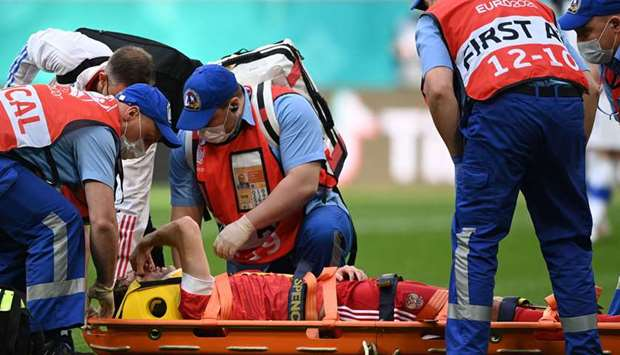 Russia's defender Mario Fernandes is stretchered off injured during the Euro 2020.