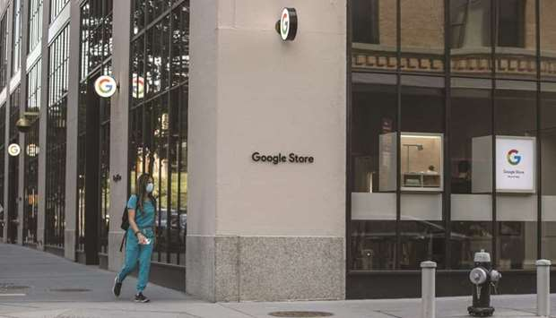 A pedestrian passes in front of the Google Store Chelsea in New York. The store will open to the pub