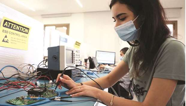 Multilane company's staff work on a circuit board at Houmal technology park in Houmal, Lebanon. It p
