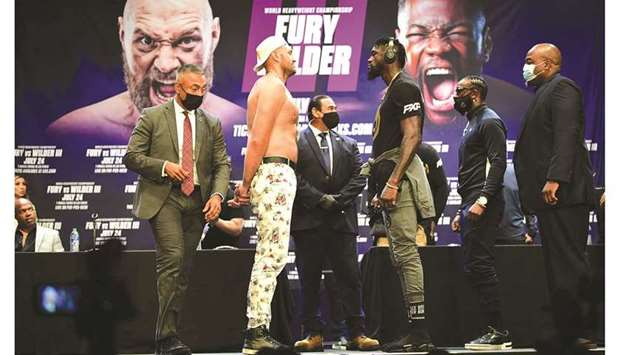 Boxers Tyson Fury and Deontay Wilder (third from right) face-off on Tuesday in Los Angeles during a