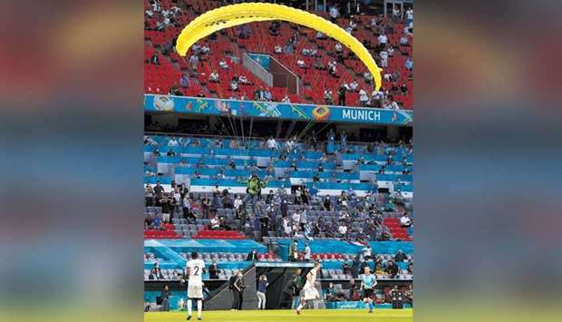 A Greenpeace protester lands on the pitch before the France-Germany Euro 2020 match at the Arena Mun