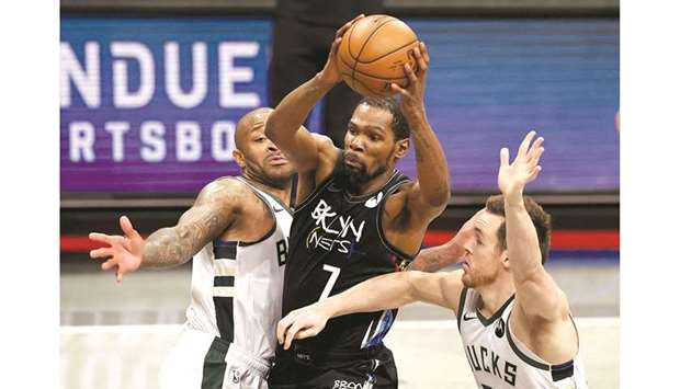 Kevin Durant of the Brooklyn Nets heads for the basket as PJ Tucker (left) and Pat Connaughton of th