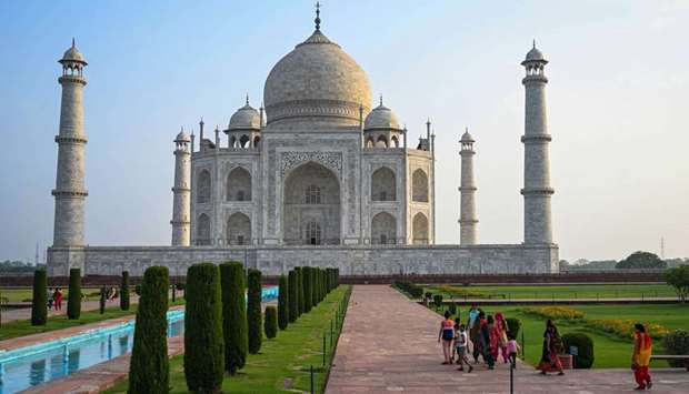Tourists visit the Taj Mahal after it reopened to visitors following authorities easing Covid-19 cor
