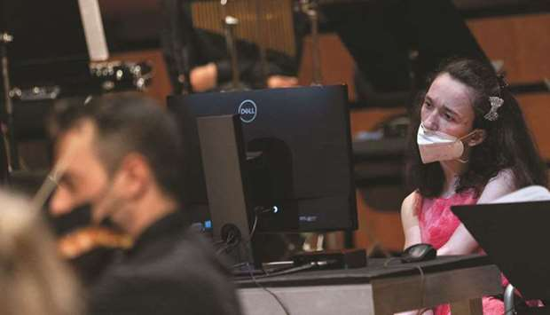 Alexandra Kerlidou, who suffers from cerebral palsy, plays the 'Eyeharp', a gaze-controlled software