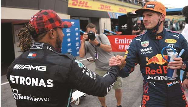 Red Bull's Max Verstappen (right) is congratulated by Mercedes' Lewis Hamilton after the former took