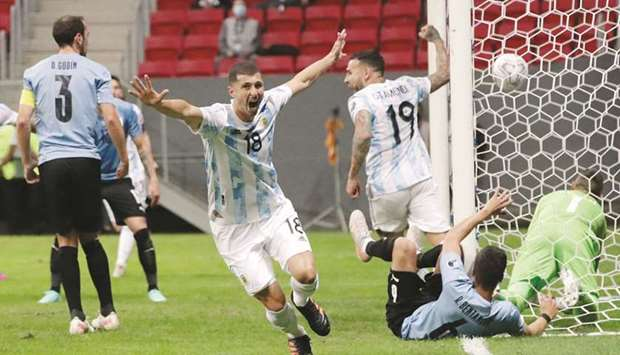 Argentina's Guido Rodriguez (centre) celebrates after scoring against Uruguay in the Copa America Gr