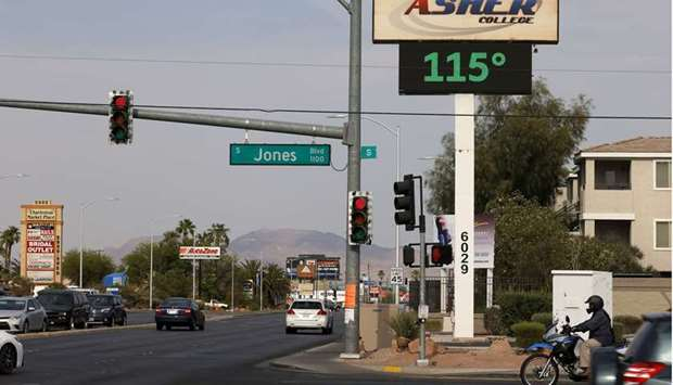 A digital sign displays a temperature of 115 degrees Fahrenheit as a heat wave continues to bake the