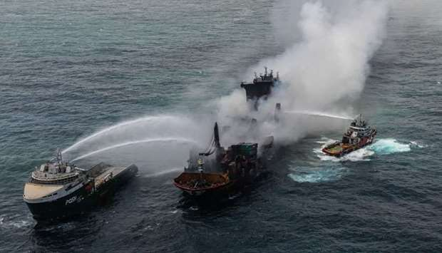 Smoke rises from a fire onboard the MV X-Press Pearl vessel in the seas off the Colombo Harbour