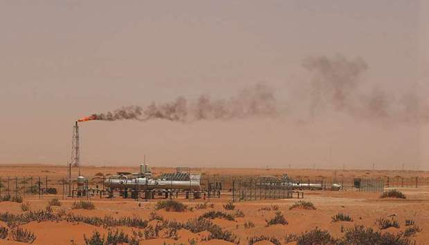 A flame from a Saudi Aramco oil installation in the desert near the oil-rich area of Khouris, 160km