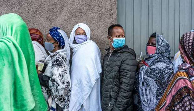 Voters queue to vote at a polling station in Addis Ababa, Ethiopia