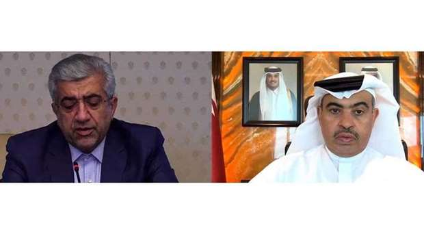 HE the Minister of Commerce and Industry and Acting Minister of Finance Ali bin Ahmed Al Kuwari hold