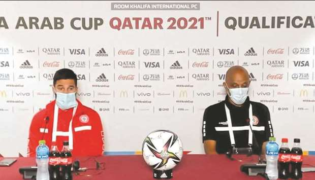 Lebanon coach Jamal Taha (right) and Hassan Maatouk attend a press conference on Tuesday.