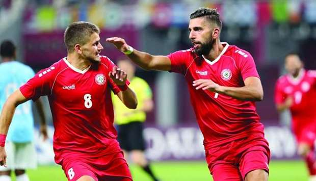 Lebanon's Hilal Alhelwe (right) celebrates with Majed Osman after scoring against Djibouti during th